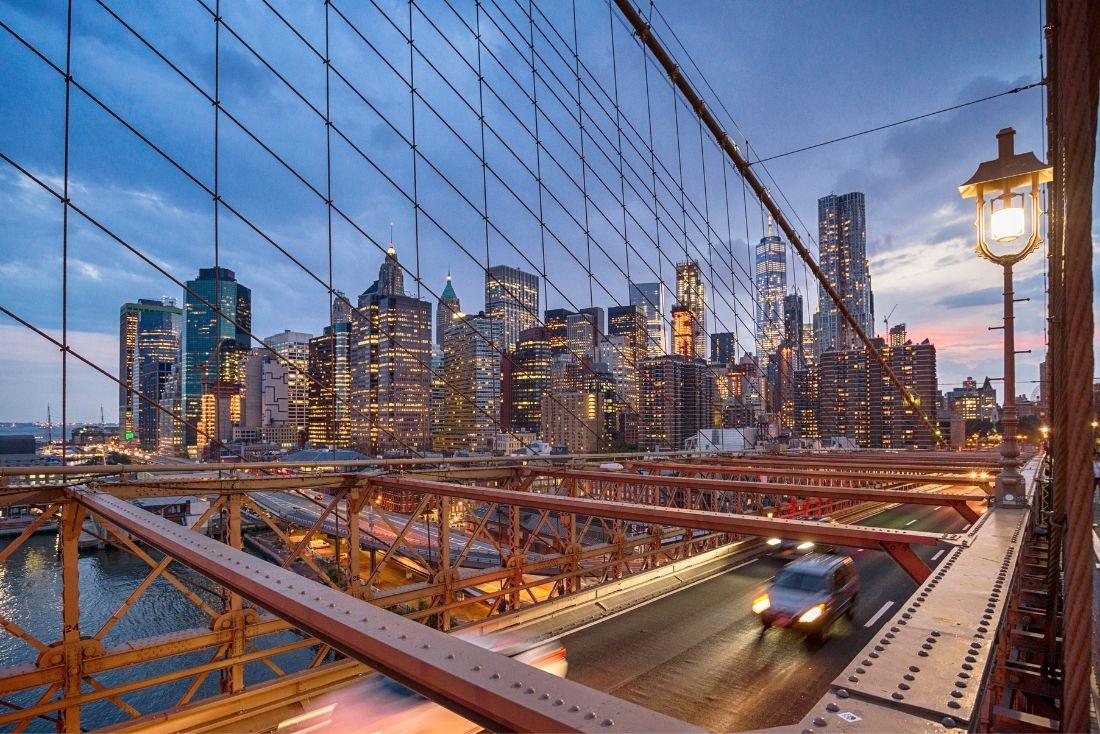 New York direct flights from Cayman see the Brooklyn Bridge